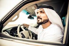 Арабский человек в его автомобиле Стоковое Изображение