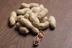Арахисы, семя арахисов, арахисы текстура виньетки, арахис Брайна Материал арахиса Стоковые Изображения RF
