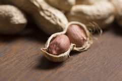 Арахисы, семя арахисов, арахисы текстура виньетки, арахис Брайна Материал арахиса Стоковая Фотография