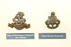 Армия значков Insignia великобританская на музее Стоковое Фото