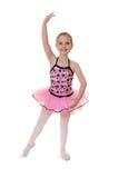 Артист балета ребенка делает Tendu в костюме стоковое изображение