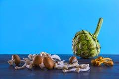 Артишок и грибы Стоковая Фотография