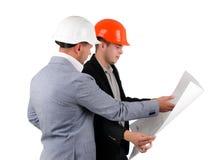 2 архитектора обсуждая план здания Стоковые Изображения RF