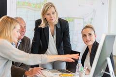 Архитекторы в офисе работая совместно Стоковое Изображение