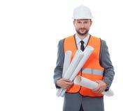 Архитектор в оранжевом удерживании жилета может завернуть планы в бумагу чертежа Стоковые Фото