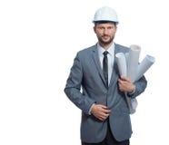 Архитектор в серой сюите держа много планов зданий Стоковые Фотографии RF