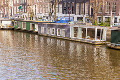 Архитектура Амстердама от шлюпки Стоковые Изображения