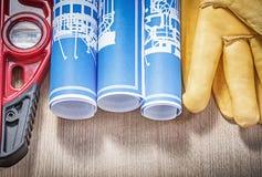 Ассортимент сини уровня конструкции кожаных перчаток blueprints Стоковое фото RF