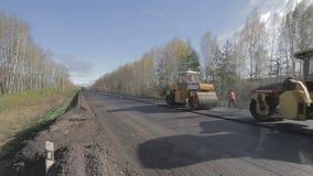 Асфальт ремонта дороги промежутка времени видеоматериал