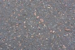 Асфальт с камнями Стоковые Фотографии RF