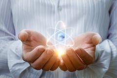 Атом в руках Стоковые Фото