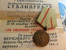 Аттестация награждает 8-ое августа 1943 и ` медали для обороны ` Сталинграда Мой дед воевать на Сталинграде Стоковое Фото