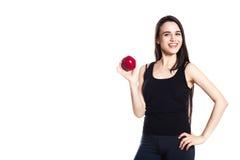 Атлетическая девушка с яблоками Портрет красивой кавказской молодой женщины спорта, космоса для текста Стоковая Фотография