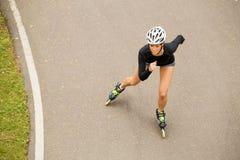 Атлетический работать конькобежца ролика Стоковая Фотография RF