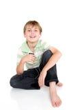 аудиоплейер мальчика вскользь стоковые фото