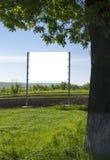 Афиша на зеленом поле Стоковая Фотография RF