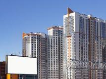 Афиша на предпосылке жилого buildin высотного здания Стоковое Изображение