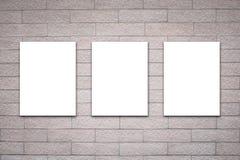 3 афиши на кирпичной стене Стоковая Фотография RF