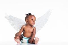 Африканская девушка в крылах. стоковое фото rf