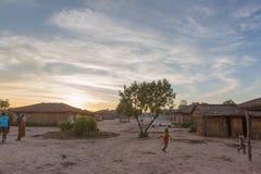 Африканская деревня с заходом солнца anisette Стоковое фото RF
