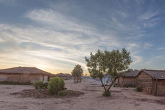 Африканская деревня с заходом солнца anisette Стоковые Изображения RF