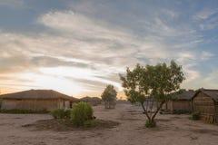 Африканская деревня с заходом солнца anisette Стоковые Фотографии RF
