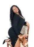Африканская женщина вставать на стуле Стоковое Изображение RF