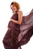 африканские красивейшие детеныши беременной женщины стоковое фото