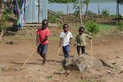 Африканские маленькие дети на спортивной площадке Стоковое Изображение