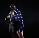 Африканский боксер с флагом задрапировал вокруг его тела Стоковые Изображения