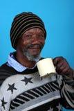африканский выпивая человек стоковое изображение rf