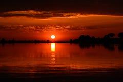 Африканский заход солнца принятый реки Chobe, Ботсваны Стоковое Изображение