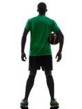 Африканский футболист человека держа силуэт футбола Стоковые Фотографии RF
