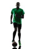Африканский футболист человека   идущий силуэт Стоковые Фото