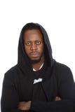 Африканский человек в черной с капюшоном верхней части Стоковые Изображения