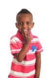 афро американский черный ребенок 7 изолировал усмешки Стоковые Фото
