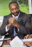 Афро-американский человек бизнесмена в встрече Стоковые Изображения RF