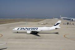 Аэробус Finnair на международном аэропорте Chubu Centrair, Японии Стоковые Фото