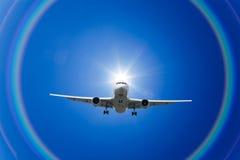 аэроплан заволакивает радуга Стоковые Изображения RF
