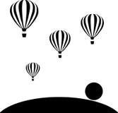 Аэростаты летая в небо на заходе солнца Стоковое фото RF