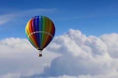 Аэростат плавая в небо дня Мультимедиа Стоковые Изображения