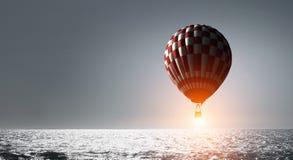 Аэростат плавая в небо дня Мультимедиа Стоковое Изображение RF