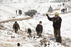 Алма-Ата, Казахстан - 21-ое февраля 2013. -дорога участвуя в гонке на виллисах, конкуренция автомобиля, ATV. Традиционная гонка Стоковое фото RF