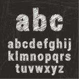 Алфавит мела на черной предпосылке Стоковые Изображения