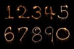 Алфавит номера света фейерверка бенгальского огня Стоковое Изображение
