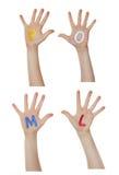 Алфавит (письма) покрашенный на руках детей Поднимают вверх руки стоковое изображение