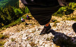 Альпинист на утесе Стоковое Изображение