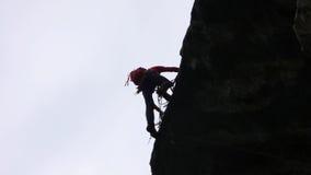 Альпинист утеса в швейцарских Альпах Стоковое Изображение RF