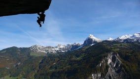 Альпинист утеса в швейцарских Альпах Стоковое Изображение