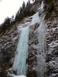 Альпинист льда в утверждает долину в Швейцарии Стоковое Изображение